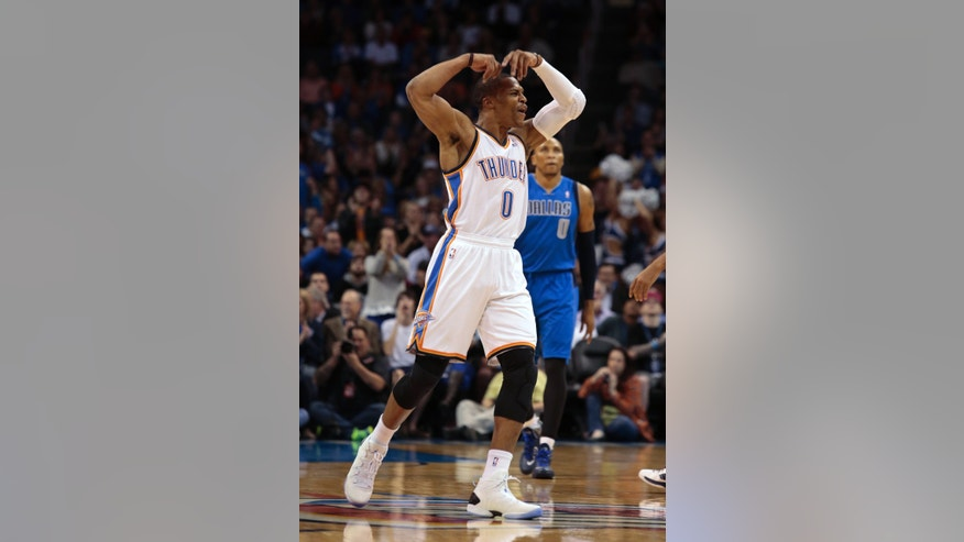 Oklahoma City Thunder point guard Russell Westbrook (0) celebrates a play in the first half of an NBA basketball game against the Dallas Mavericks in Oklahoma City, Wednesday Nov. 6, 2013. (AP Photo/Brett Deering)