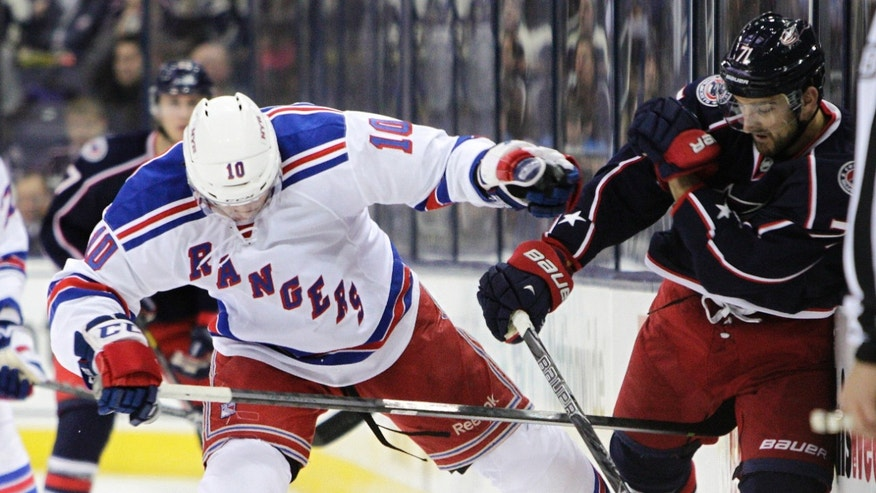 New York Rangers' JT Miller, left, collides with Columbus Blue Jackets' Nick Foligno during the second period of an NHL hockey game Thursday, Nov. 7, 2013, in Columbus, Ohio. (AP Photo/Jay LaPrete)