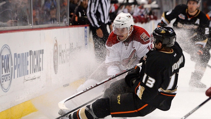 Phoenix Coyotes right wing Shane Doan, left, and Anaheim Ducks center Nick Bonino battle for the puck during the second period of an NHL hockey game Wednesday, Nov. 6, 2013, in Anaheim, Calif. (AP Photo/Mark J. Terrill)