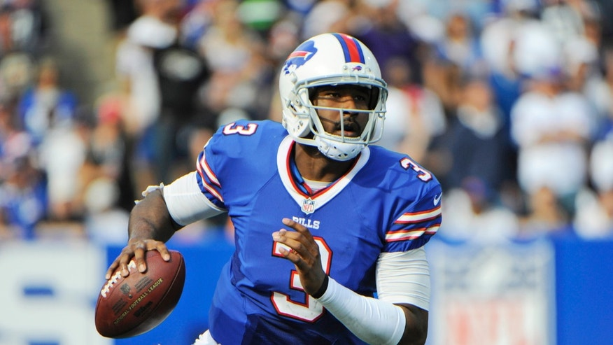 FILE - In this Sept. 29, 2013 file photo, Buffalo Bills quarterback EJ Manuel (3) looks to pass against the Baltimore Ravens during the second half of an NFL football game in Orchard Park, N.Y. The Bills rookie quarterback on Monday, Nov. 4, 2013, declared himself ready to return after missing four weeks with a sprained right knee. All that's standing in Manuel's way is a green light from coach Doug Marrone. (AP Photo/Gary Wiepert, File)
