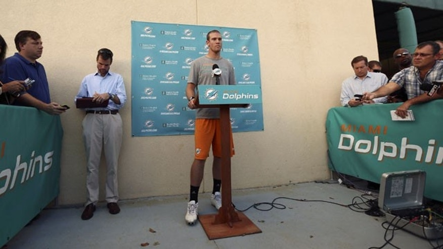 November 6, 2013: Miami Dolphins quarterback Ryan Tannehill talks to the media during a news conference after practice at the Dolphins training center in Davie, Fla. (AP Photo)