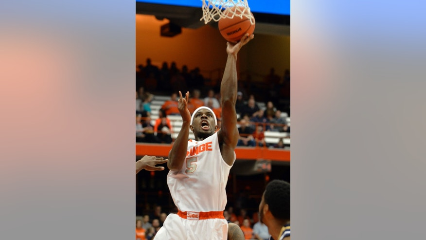 Syracuse's C. J. Fair scores against Ryerson during the second half of a men's NCAA exhibition basketball game in Syracuse, N.Y., Tuesday, Nov. 5, 2013. Syracuse won 81-46. (AP Photo/Kevin Rivoli)