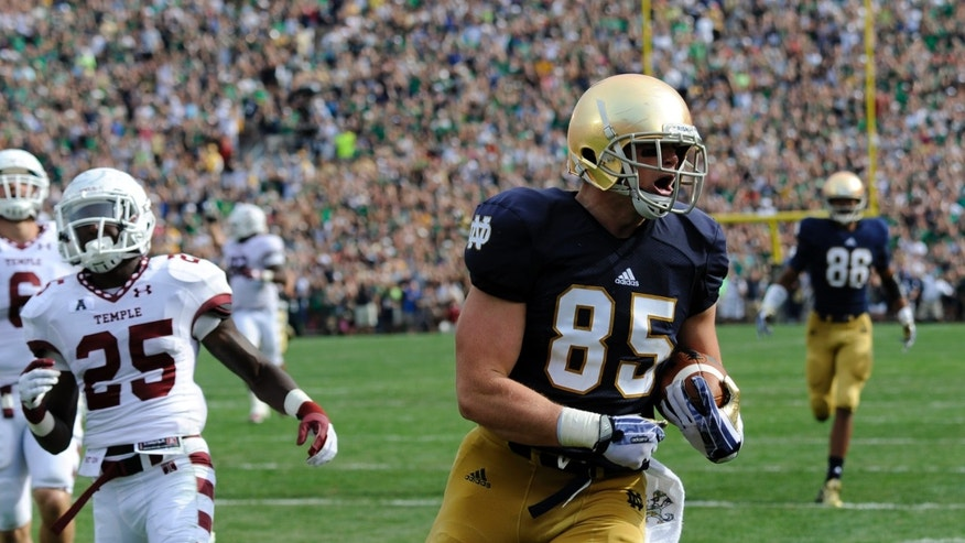 "In this Aug. 31, 2013 photo, Notre Dame tight end Troy Niklas crosses the goal line for a touchdown against Temple, in South Bend, Ind. Niklas is intimidating figure to opponents at 6-foot-6, 270 pounds and a physique so impressive former teammate Manti Te'o gave him the nickname ""Hercules.""(AP Photo/Joe Raymond)"