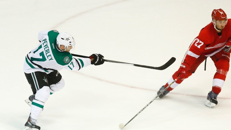 Dallas Stars center Rich Peverley (17) shoots the game winning goal against the Detroit Red Wings in overtime of an NHL hockey game in Detroit Thursday, Nov. 7, 2013. Dallas won 4-3. (AP Photo/Paul Sancya)