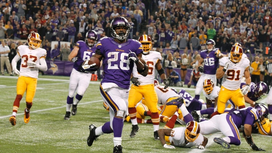 Minnesota Vikings running back Adrian Peterson (28) runs to the end zone on a 1-yard touchdown run during the second half of an NFL football game against the Washington Redskins, Thursday, Nov. 7, 2013, in Minneapolis. (AP Photo/Ann Heisenfelt)