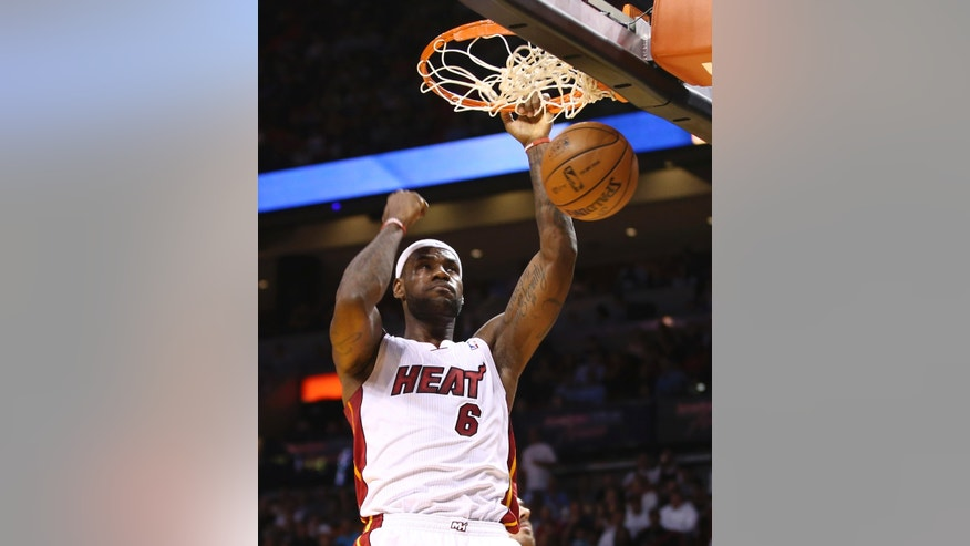 Miami Heat's LeBron James  dunks for two points against the Los Angeles Clippers during the first half of an NBA basketball game in Miami, Thursday, Nov. 7, 2013. (AP Photo/J Pat Carter)