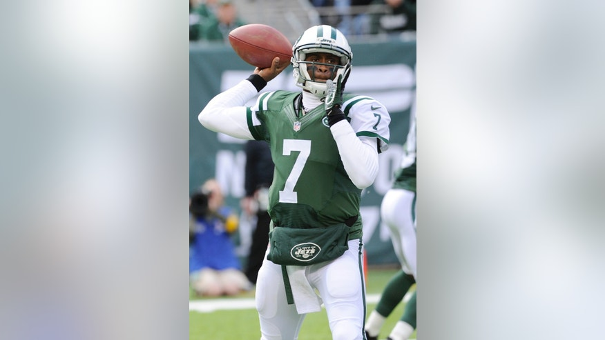 New York Jets quarterback Geno Smith (7) throws a pass during the first half of an NFL football game against the New Orleans Saints Sunday, Nov. 3, 2013, in East Rutherford, N.J.  (AP Photo/Bill Kostroun)