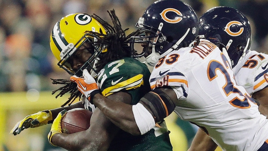 Chicago Bears' Charles Tillman (33) grabs the face mask of Green Bay Packers' Eddie Lacy during the second half of an NFL football game Monday, Nov. 4, 2013, in Green Bay, Wis. The Bears won 27-20. (AP Photo/Mike Roemer)
