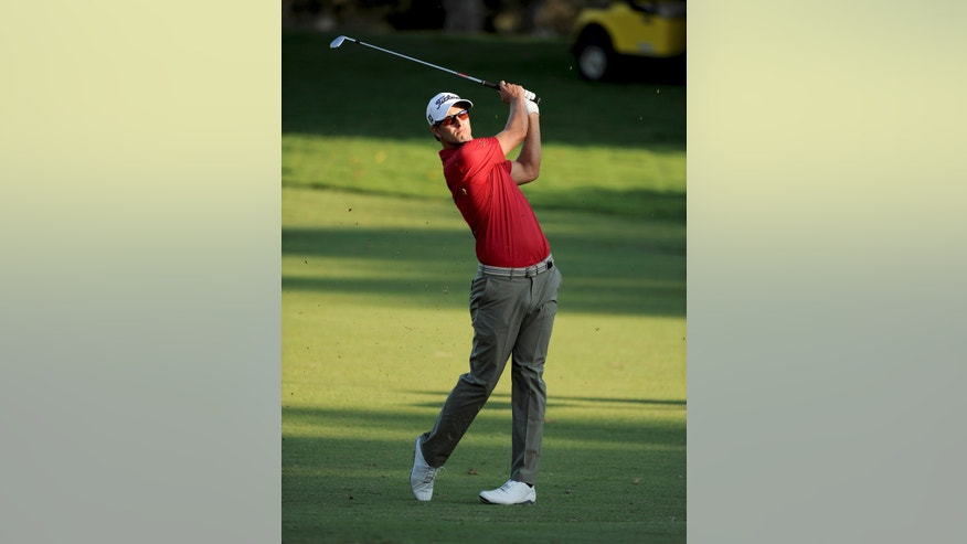 In this photo released by OneAsia, Adam Scott of Australia plays a shot during the first round of the Australian PGA Championship at the RACV Royal Pines Resort golf club on Australia's Gold Coast Thursday, Nov. 7, 2013. (AP Photo/OneAsia, Khalid Redza) NO LICENSING