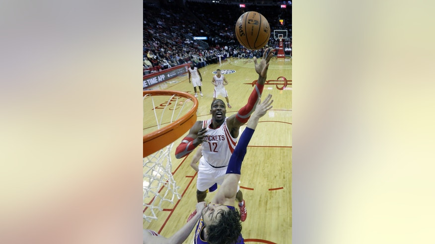 Houston Rockets' Dwight Howard (12) shoots as Los Angeles Lakers' Pau Gasol, bottom, defends during the first quarter of an NBA basketball game Thursday, Nov. 7, 2013, in Houston. (AP Photo/David J. Phillip)