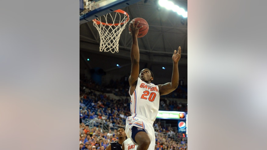 Florida guard Michael Frazier II lays-up a shot during the first half of an NCAA college Basketball game against North Florida, Friday, Nov. 8, 2013, in Gainesville, Fla. (AP Photo/Phil Sandlin)