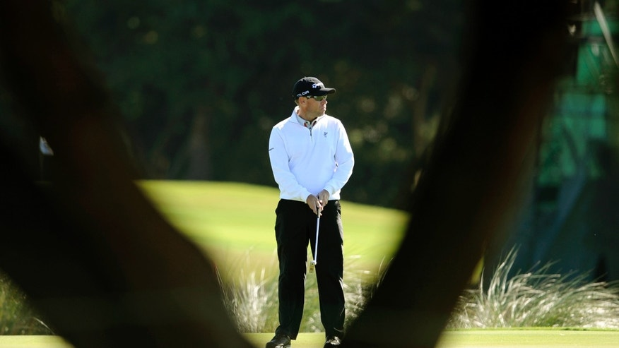 Brian Davis, of England, watches his putt on the 13th green during the second round of the McGladrey Classic golf tournament on Friday, Nov. 8, 2013, in St. Simons Island, Ga. (AP Photo/Stephen Morton)