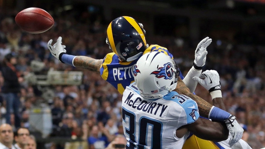 St. Louis Rams wide receiver Austin Pettis tries to catch pass in the end zone as Tennessee Titans cornerback Jason McCourty defends in the fourth quarter of an NFL football game Sunday, Nov. 3, 2013, in St. Louis. (AP Photo/Jeff Roberson)