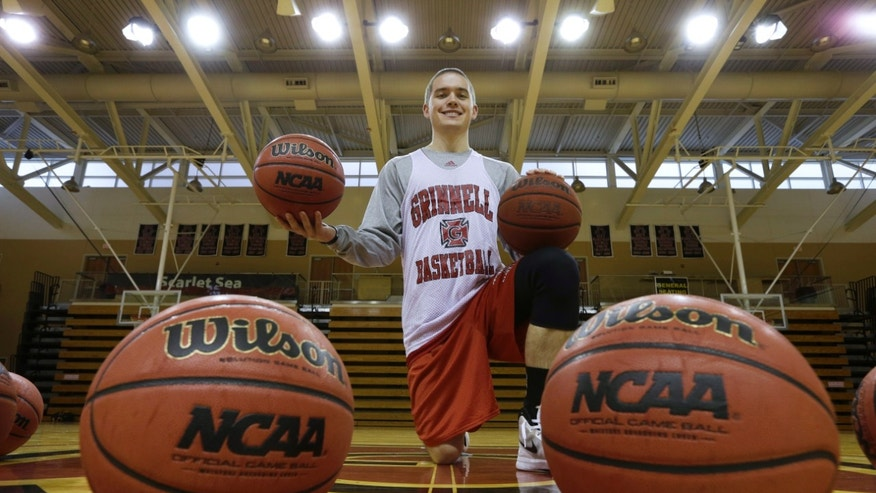 ADVANCE FOR WEEKEND EDITIONS, NOV. 9-10 -In this Oct. 30, 2013 photo, Grinnell College guard Jack Taylor poses for a photo before an NCAA basketball practice in Grinnell, Iowa.  (AP Photo/Charlie Neibergall)
