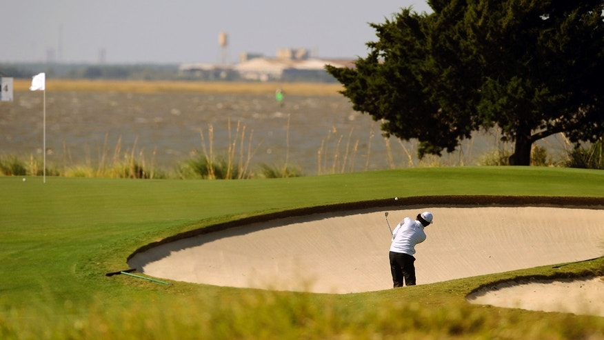 Martin Flores hits out of the bunker on the 13th hole during the second round of the McGladrey Classic golf tournament on Friday, Nov. 8, 2013, in St. Simons Island, Ga. (AP Photo/Stephen Morton)