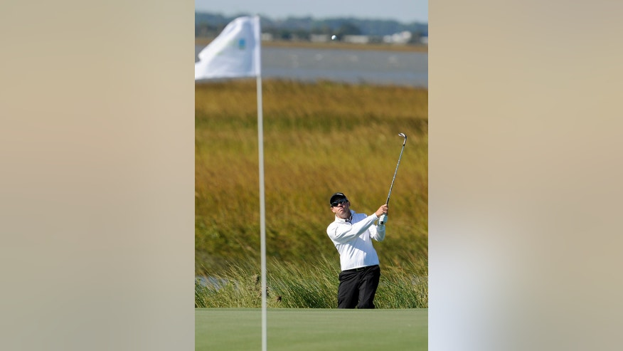 Brian Davis, of England, watches his shot onto the 14th green during the second round of the McGladrey Classic golf tournament on Friday, Nov. 8, 2013, in St. Simons Island, Ga. (AP Photo/Stephen Morton)