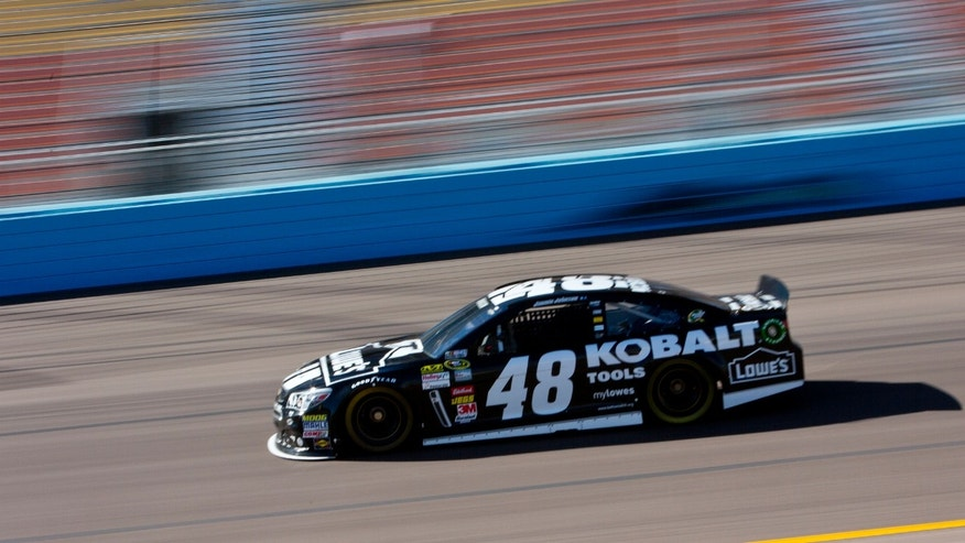 Jimmie Johnson drives during practice for the NASCAR Sprint Cup Series auto race at Phoenix International Raceway on Friday, Nov. 8, 2013, in Avondale, Ariz. (AP Photo/The Arizona Republic, Patrick Breen) MARICOPA COUNTY OUT  NO SALES