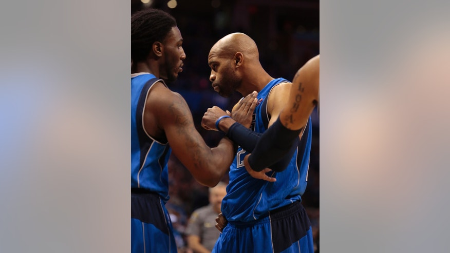 Dallas Mavericks shooting guard Vince Carter (25) leaves the court after being ejected during the NBA basketball game against the Oklahoma City Thunder in Oklahoma City, Wednesday Nov. 6, 2013. (AP Photo/Brett Deering)