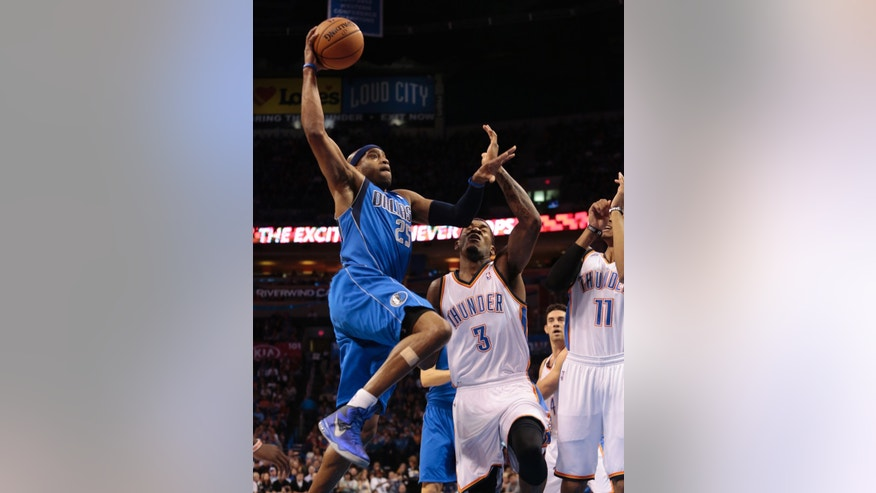 Dallas Mavericks shooting guard Vince Carter (25) shoots over Oklahoma City Thunder small forward Perry Jones (3) during the first half of an NBA basketball game in Oklahoma City, Wednesday Nov. 6, 2013. (AP Photo/Brett Deering)