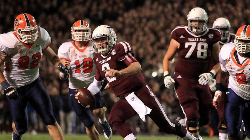 Texas A&M's Johnny Manziel, center, runs the ball upfield during the first half of an NCAA college football game against UTEP, Saturday, Nov. 2, 2013, in College Station, Texas. (AP Photo/Eric Christian Smith)