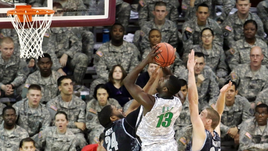 Oregon's Richard Amardi (13) tries to shoot against Georgetown's Joshua Smith (24) and Nate Lubik (34) during the first half of an NCAA college basketball game in the Armed Forces Classic at Camp Humphreys in Pyengtaek, south of Seoul, South Korea, Saturday, Nov. 9, 2013. (AP Photo/Lee Jim-man)