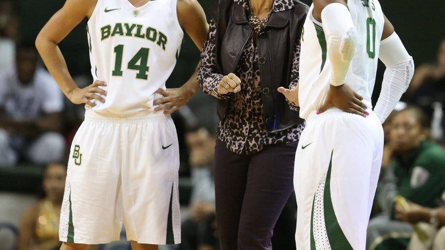 Baylor coach Kim Mulkey, center, talks with Odyssey Sims, right, and Makenzie Robertson during a break in the first half of an NCAA college basketball exhibition game against Oklahoma City, Tuesday, Nov. 5, 2013, in Waco, Texas. (AP Photo/Waco Tribune Herald, Rod Aydelotte)