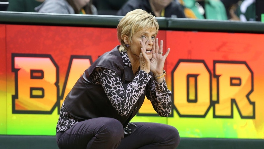 Baylor coach Kim Mulkey call in a play against Oklahoma City in the first half of an NCAA college basketball exhibition game, Tuesday, Nov. 5, 2013, in Waco, Texas. (AP Photo/Waco Tribune Herald, Rod Aydelotte)
