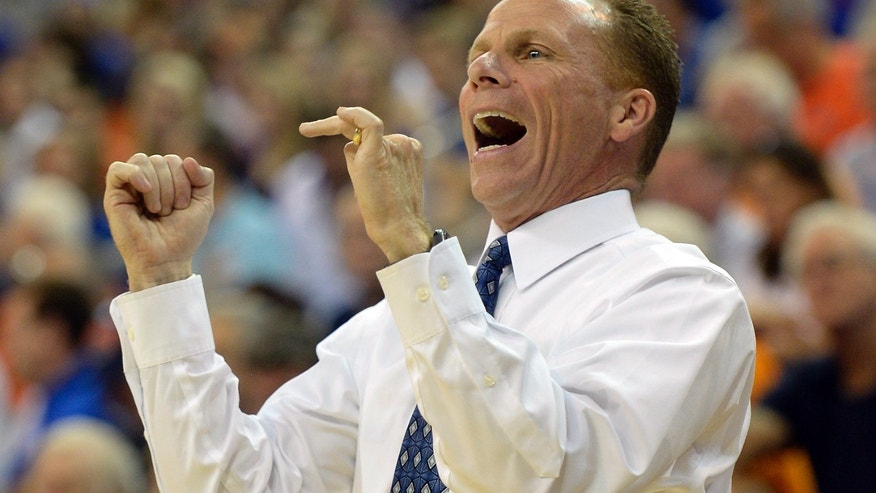 North Florida coach Matthew Driscoll shouts encouragement to this team during the first half of an NCAA college basketball game against Florida Friday, Nov. 8, 2013, in Gainesville, Fla. Florida won 77-69. (AP Photo/Phil Sandlin