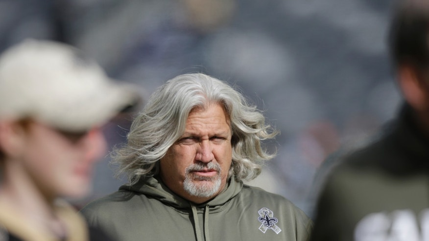 FILE - In this Nov. 3, 2013 file photo, New Orleans Saints defensive coordinator Rob Ryan walks on the field before an NFL football game against the New York Jets, in East Rutherford, N.J.  Dallas Cowboys' Jason Hatcher gives Ryan most of the credit for a transformation that has him second among NFC sack leaders in 2013. Now the Cowboys get to face their old defensive coordinator less than a year after he was fired and ended up in New Orleans. (AP Photo/Mel Evans, File)