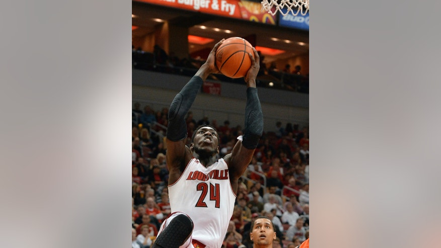 Louisville's Montrezl Harrell goes up for a shot during the second half of an NCAA college basketball exhibition game, Wednesday, Nov. 6, 2013, in Louisville, Ky. Louisville defeated Pikeville 90-61. (AP Photo/Timothy D. Easley)