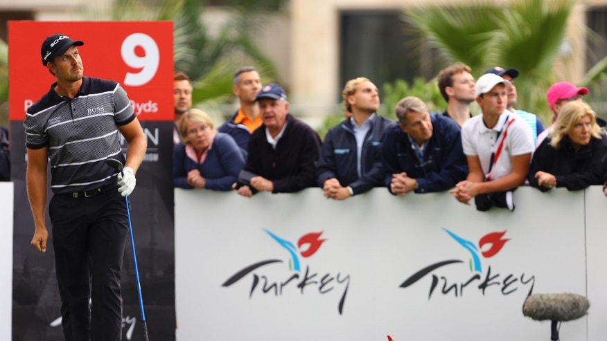 Sweden's Henrik Stenson watches the flight of his tee shot at the 9th hole during the first round of the Turkish Airlines Open golf tournament at the Montgomerie Maxx Royal Course in Antalya, Turkey, Thursday, Nov. 7, 2013. (AP Photo/Kaan Soyturk)