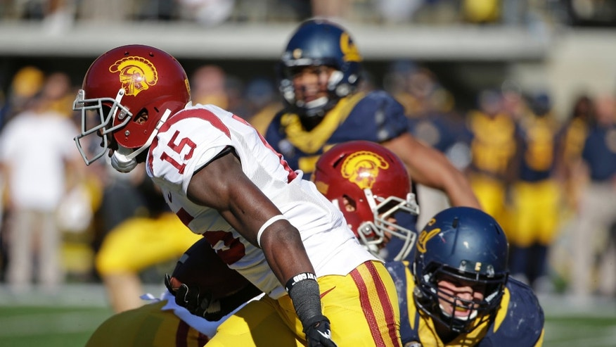 Southern California wide receiver Nelson Agholor runs with the ball on a punt return for a 93-yard touchdown during the second quarter of an NCAA college football game against California on Saturday, Nov. 9, 2013, in Berkeley, Calif. (AP Photo/Eric Risberg)