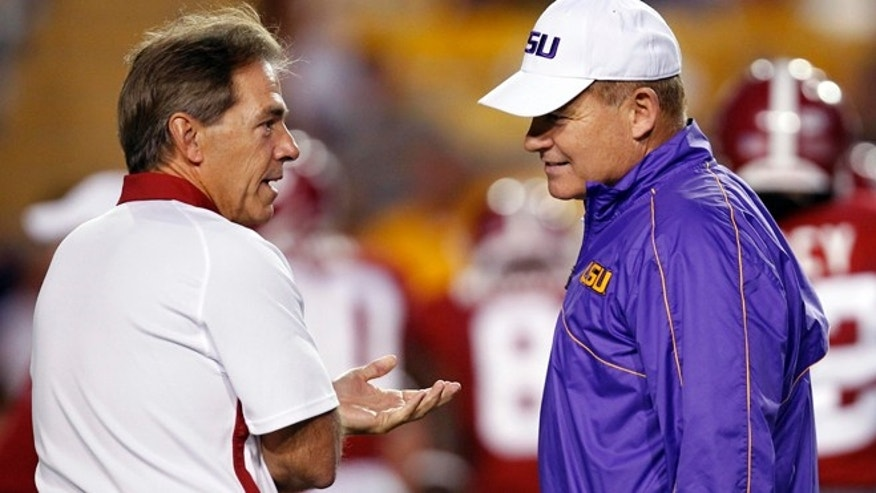 FILE 2012: file Alabama head coach Nick Saban, left, and LSU head coach Les Miles greet each other before their NCAA college football game in Baton Rouge, La.