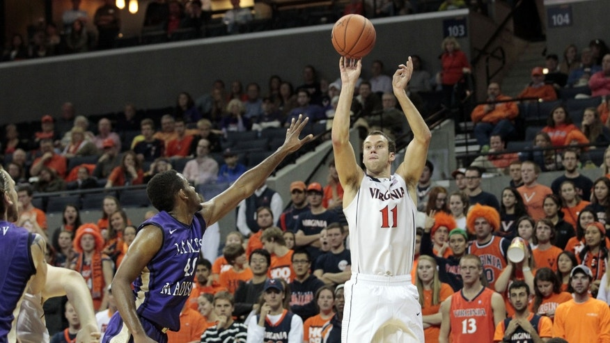 Virginia forward Evan Nolte (11) shoots over James Madison forward Yohanny Dalembert (40) during the second half of an NCAA college basketball game on Friday, Nov. 8, 2013, in Charlottesville, Va. (AP Photo/Ryan M. Kelly)