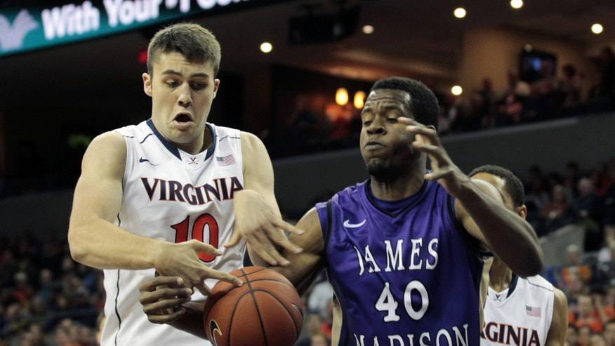 Virginia forward Mike Tobey (10) and James Madison forward Yohanny Dalembert (40) fight for control of the ball during the first half of an NCAA college basketball game on Friday, Nov. 8, 2013, in Charlottesville, Va. (AP Photo/Ryan M. Kelly)