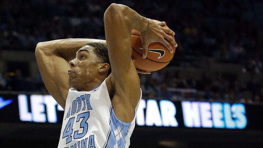 North Carolina's James Michael McAdoo drives to the basket during the first half of an NCAA college basketball game against Oakland in Chapel Hill, N.C., Friday, Nov. 8, 2013. (AP Photo/Gerry Broome)