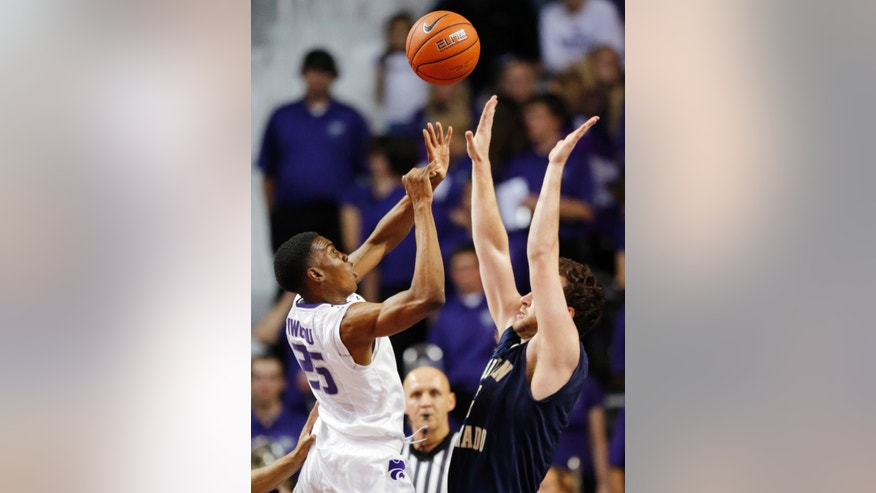 Kansas State forward Wesley Iwundu (25) shoots over Northern Colorado center Brendan Keane, right, during the first half of an NCAA college basketball game in Manhattan, Kan., Friday, Nov. 8, 2013. (AP Photo/Orlin Wagner)