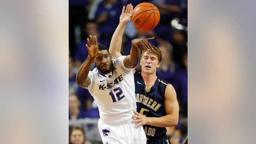 Kansas State guard Omari Lawrence (12) passes to a teammate while Northern Colorado guard Tevin Svihovec (5) defends during the first half of an NCAA college basketball game in Manhattan, Kan., Friday, Nov. 8, 2013. (AP Photo/Orlin Wagner)