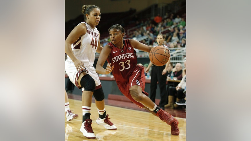 Stanford's Amber Orrange (33) drives on Boston College's Kat Cooper during the second half of Stanford's 83-71 win in an NCAA college basketball game at Conte Forum in Boston Saturday, Nov. 9, 2013. (AP Photo/Winslow Townson)