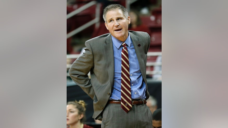 Boston College head coach Erik Johnson looks on  during the second half of their 83-71 loss to Stanford in an NCAA college basketball game at Conte Forum in Boston Saturday, Nov. 9, 2013. (AP Photo/Winslow Townson)
