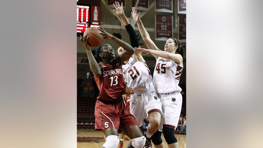 Stanford's Chiney Ogwumike (13) looks to go to the basket past Boston College's Kristen Doherty (21) and Katie Zenevitch during the first half of an NCAA college basketball game at Conte Forum in Boston Saturday, Nov. 9, 2013. (AP Photo/Winslow Townson)