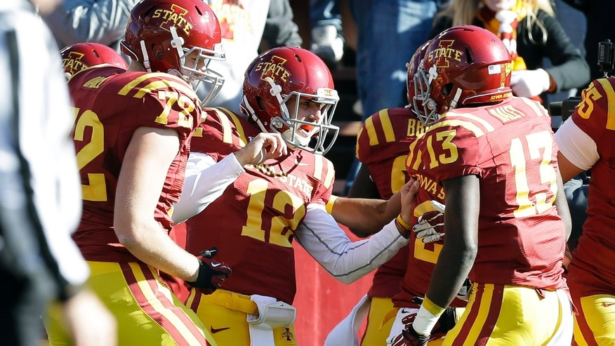 Iowa State quarterback Sam B. Richardson, center, celebrates with teammates after scoring on a 15-yard touchdown run during the first half of an NCAA college football game against TCU, Saturday, Nov. 9, 2013, in Ames, Iowa. (AP Photo/Charlie Neibergall)