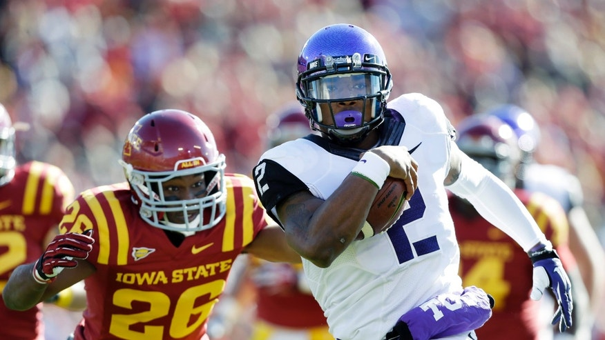 TCU quarterback Trevone Boykin runs from Iowa State defensive back Deon Broomfield, left, during an 18-yard touchdown run in the first half of an NCAA college football game, Saturday, Nov. 9, 2013, in Ames, Iowa. (AP Photo/Charlie Neibergall)