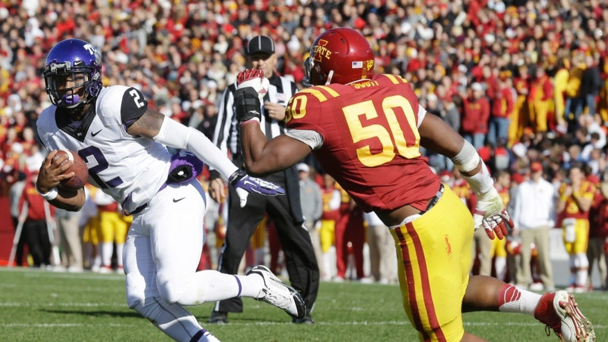 TCU quarterback Trevone Boykin, left, runs from Iowa State defensive end Willie Scott during a 3-yard touchdown run in the first half of an NCAA college football game, Saturday, Nov. 9, 2013, in Ames, Iowa. (AP Photo/Charlie Neibergall)