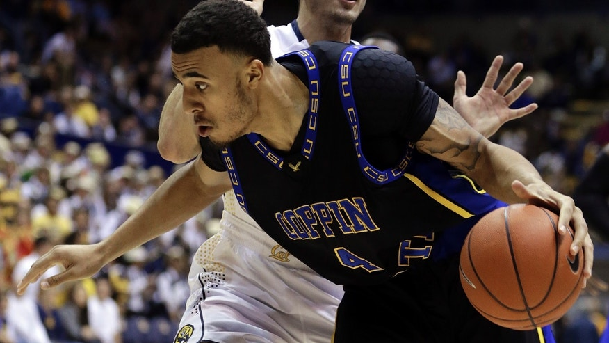 Coppin State's Zach Burnham (4) drives the ball past California's Ricky Kreklow in the first half of an NCAA college basketball game Friday, Nov. 8, 2013, in Berkeley, Calif. (AP Photo/Ben Margot)