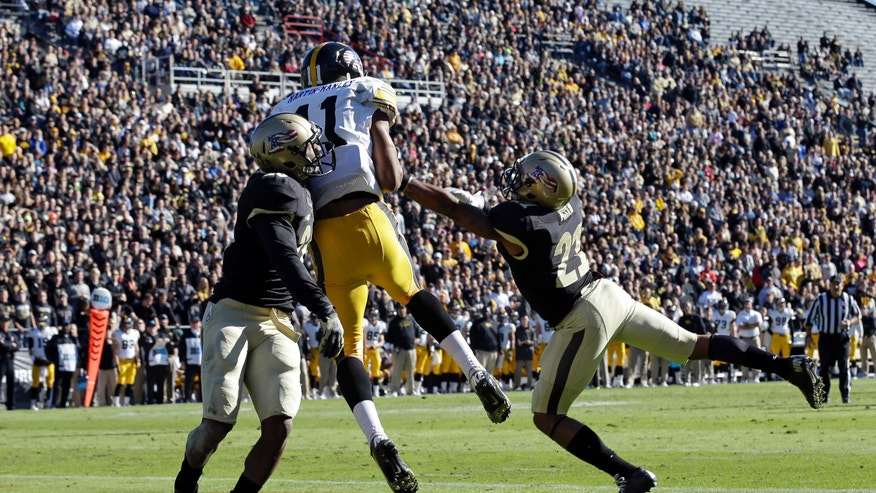 Iowa wide receiver Kevonte Martin-Manley makes a catch for a touchdown between  Purdue cornerback's Antoine Lewis, left, and Ricardo Allen, right, during the first half of an NCAA college football game in West Lafayette, Ind., Saturday, Nov. 9, 2013. (AP Photo/Michael Conroy)