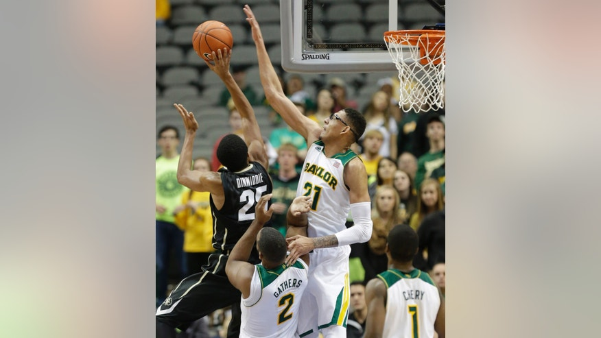 Baylor center Isaiah Austin (21) blocks a shot by Colorado guard Spencer Dinwiddie (25) as Baylor forward Rico Gathers (2) gets in the middle during the first half of an NCAA college basketball game in Dallas, Friday, Nov. 8, 2013. (AP Photo/LM Otero)