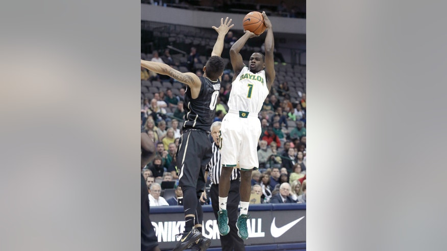 Baylor guard Kenny Chery (1) shoots against Colorado Askia Booker (0) during the first half of an NCAA college basketball game in Dallas, Friday, Nov. 8, 2013.  (AP Photo/LM Otero)