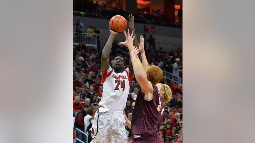 Louisville's Montrezl Harrell, left, puts up a shot over the defense of the College of Charleston's David Wishon, front right, and Canyon Barry during the second half of an NCAA college basketball game, Saturday, Nov. 9, 2013, in Louisville, Ky. Louisville defeated the College of Charleston 70-48. (AP Photo/Timothy D. Easley)