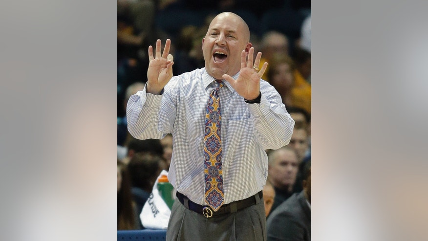 Marquette head coach Buzz Williams signals to his players during the second half of an NCAA college basketball game against Southern University Friday, Nov. 8, 2013, in Milwaukee. (AP Photo/Morry Gash)